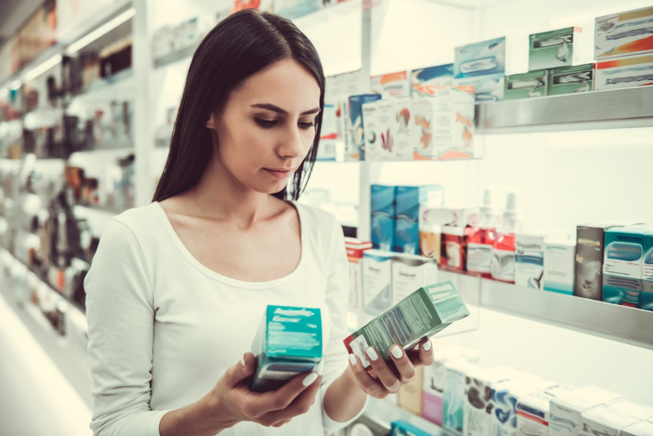 Woman shopping for over the counter drugs